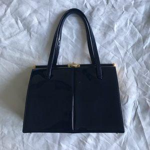 Vintage Riviera Bay leather navy bag bar closure